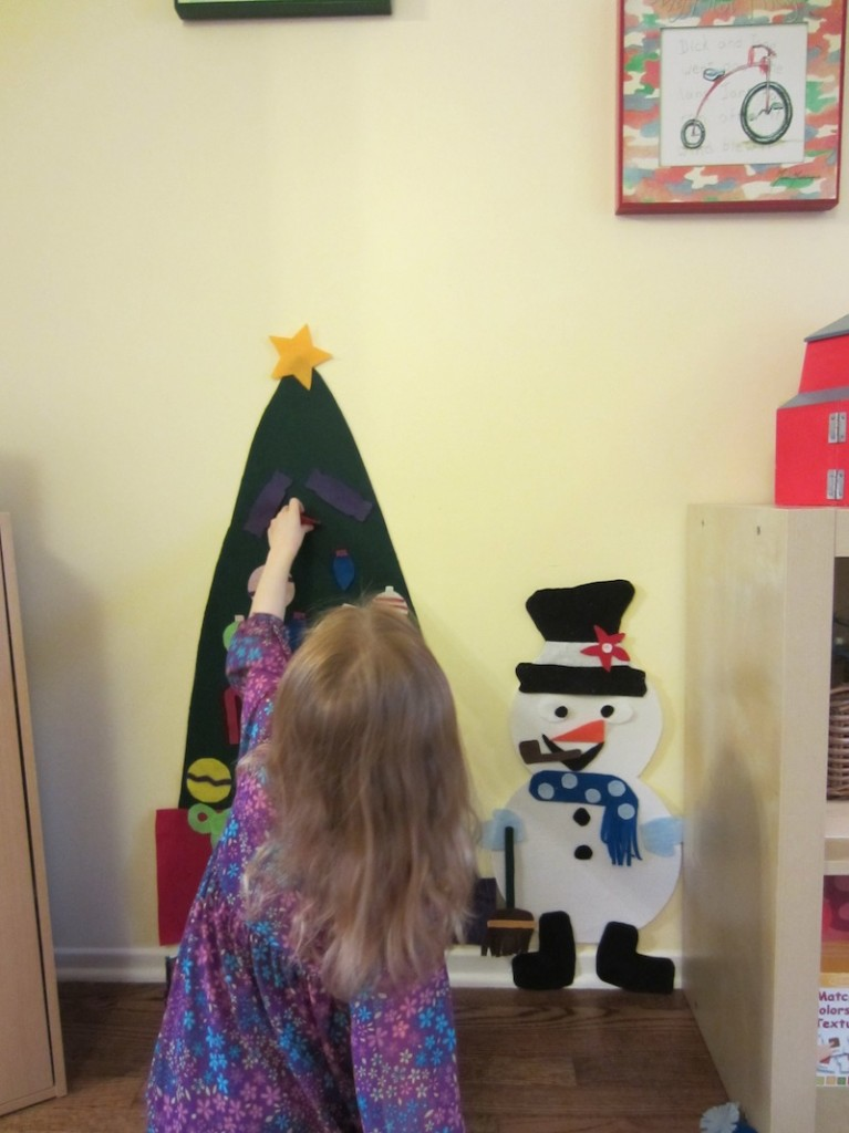 felt-tree-child-decorating